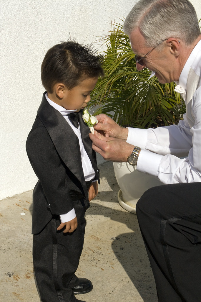 Dad pinning on nephew (and ring bearer) Dylan's corsage