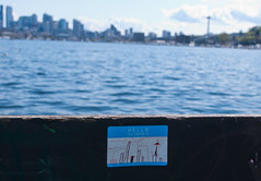 075 (Fearless Zombie) Tags: seattle park lake art public graffiti washington spring sticker sunny bluesky wa spaceneedle lakeunion publicart nametag gasworkspark wallingford hellomynameis publicpark seattlepark