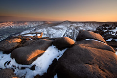 Scouting for Kinder Eggs (Paul Newcombe) Tags: uk winter sunset snow mountains english easter walking landscape photography nationalpark spring rocks view hiking plateau derbyshire peakdistrict wideangle hills april vista peaks tamron darkpeak edale gritstone edalevalley 1024 kinderscout wintry happyeaster aprilshowers sidelight britishsummertime grindsbrook britnatparks kindergrit