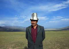 Man Wearing A Kalpak Hat, Saralasaz Jailoo, Kyrgyzstan (Eric Lafforgue) Tags: 1461 kyrgyzstan asia centralasia horizontal humanbeing person people one oneperson man male bluesky clouds exterior horizon traditionalhat traditi