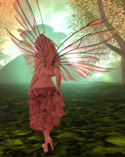 Picture Description: Faerie in Mauve, her back to the camera, walking toward a green-lit set of hills.