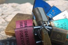 Padlocks (Laura.1606) Tags: travel bridge summer italy holiday love words august ponte verona messages pietra 2009 padlocks