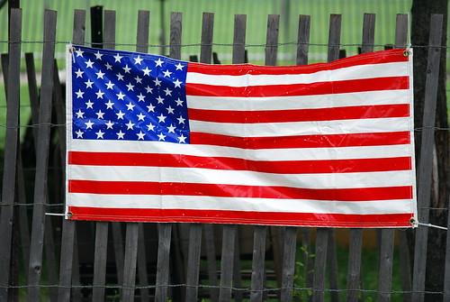 Big Flag on Fence