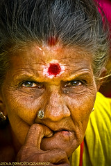portrait of a beautiful old lady at the market madurai- மதுரை-tamil nadu-தமிழ் நாடு-south india (anthony pappone photography) Tags: portrait people india colors yellow digital canon photography photo colours colore faces image expression retrato picture culture portraiture oldlady earrings fotografia ritratto madurai tamil tamilnadu reportage southindia photograher phototravel भारत 인도 الهند eos400d earthasia インドの