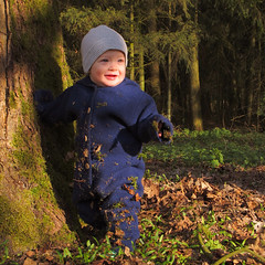A little man stands in the forest (Batikart) Tags: blue light boy sunset portrait people baby sun sunlight white tree green nature smile face grass leaves forest canon germany geotagged happy deutschland evening licht leaf kid spring gesicht europa europe sonnenuntergang child play hand laub natur kind foliage cap april gras grn satisfaction blau beanie 1year ursula blatt sonne wald bltter weiss baum bielefeld junge 2012 frhling lcheln spielen sander mensch g11 satisfied glcklich abends frhjahr northrhinewestphalia zufrieden 100faves 201205 batikart sennestadt eckardtsheim canonpowershotg11