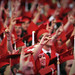 Wolf hands emerge from a sea of red gowns and graduates.