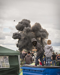 kids terror (malc_smith) Tags: children gun child mask smoke explosion terrorist boom airshow terror getty guns balaclava
