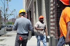 Trio (christing-O-) Tags: newyorkcity orange man yellow brooklyn lunch williamsburg worker job