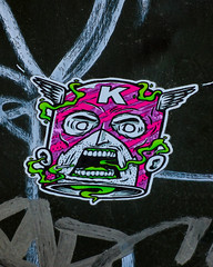 Kain in a Can (Steve Taylor (Photography)) Tags: k can wings winged teeth face green fumes smoking mask stubble cigarette art cartoon graffiti sticker streetart tag black grey mauve purple white fun scary newzealand nz southisland canterbury christchurch cbd city captain