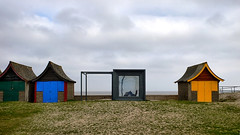 Mablethorpe (lincoln_eye) Tags: uk greatbritain winter sea england reflection window grass wall architecture modern square march seaside sand europe colours cloudy unitedkingdom eu overcast lincolnshire roofs frame cube gb railings beachhuts 2014 mablethorpe