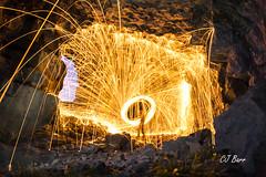 Fire Rain1 (Calvin Barr) Tags: longexposure light portrait wool night self dark painting fire wire long exposure shot fireworks flash great creative rocky remote cave llandudno conwy orme selfie