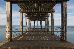 Boxing Ring (scarlet-pimp) Tags: wood symmetrical landscape promenade pier beams canon5d nd10 northyorkshire ladder ndfilter symmetry whitby civilengineering architecture longexposure westpier horizon harbour boxingring