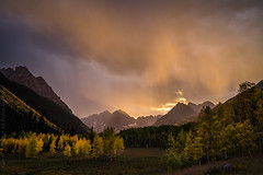 Stormy Maroon Sunset III (Kurt Lawson) Tags: aspen aspens batch1 bells color colorado copyrighted creek crepuscular deadlybells fall maroon maroonbells mountain nationalforest peak rain rock rockies snow snowmass sunset thunderstorm trees whiterivernationalforest wilderness unitedstates