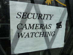 Streets is watching (silverfuture) Tags: shadow sign warning gate security clipart signage bigbrother logansquare camcorder lowtech securitycameraswatching