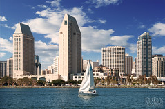 sailing in spring time san diego (Kris Kros) Tags: california ca building beach clouds sailboat digital bay boat spring high san warm downtown day sailing time touch great diego sunny manipulation sd socal highrise kris sail rise coronado kk bldg kkg blending kros kkgallery itoldyouitsnothdr