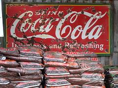 Coca-Cola Sign & Potting Soil (Woodbury, Tn) (bamaboy1941) Tags: signs tn cocacola softdrink woodbury sodasigns
