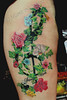 clef with flowers and ivy tattoo by Mirek vel Stotker