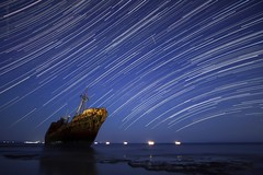 starship (helen sotiriadis) Tags: longexposure blue sea sky seascape night canon stars landscape rust published ship greece shipwreck startrails canonefs1022mmf3545usm dimitrios aghios earthandspace gytheion canoneos40d competition:astrophoto=2012