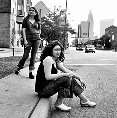 Osinsky Sisters Smoking on Corner 2 (neohypofilms) Tags: street wood city portrait bw white cute classic 120 film june sisters portraits square wooden shoes downtown candid cleveland platform style smoking sidewalk jeans 70s clogs heels denim series medium format casual females grainy 1970s curb mules platforms 2011 vintgae hassalblad cigerttes grtitty