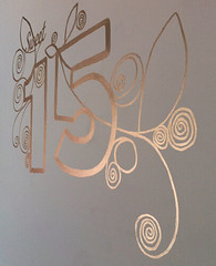 white wall with sweet 15 in gold paint