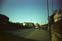 Halifax Road (Saturated Imagery) Tags: road film 35mm town iso200 toycamera wideangle halifax vignette expiredfilm calderdale vivitarultrawideandslim epsonv500 scotchcolour200