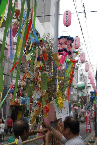 Men preparing the streamers for Tanabata festival 2