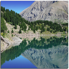 Cloves of blue (Nespyxel) Tags: mountain france alpes reflections landscape lago mirror lac mount monte provence riflessi alpi francia specchio provenza clove reflexes allos lakescape spicchio simmetrie symmetries colorphotoaward nespyxel stefanoscarselli