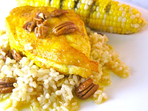 Orange pecan chicken over steamed brown rice