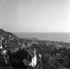 Wet roofs 3 (gandalphthegrey) Tags: rooftops roofs hastings 1970s ensign
