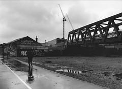 Brick Lane (Luca Tabarrini) Tags: london analog darkroom 35mm blackwhite analogue canonae1 bricklane kodaktmax400 biancoenero analogico cameraoscura ilfordmgiv vivitar28mm lucatabarrini