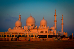 Sheikh Zayed Mosque at dusk (modenadude) Tags: pink blue sunset orange beautiful architecture night dark giant big dusk minaret gorgeous islam prayer uae mosque abudhabi gigantic domes unitedarabemirates hdr masjid mughal photomatix sheikhzayedmosque