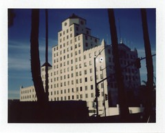 Black Sun in the Window (brian-moore) Tags: california film architecture fuji longbeach instant analogue blacksun packfilm polaroid210 fp100c oceancenterbuilding