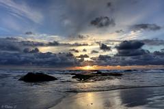 Glimpse of Sunlight (Didenze) Tags: sunset sun seascape texture beach clouds reflections raw glow explore pacificocean lowtide orangecounty sunrays sanclemente stormyclouds lightreflections canonrebelxsi exposurefusion didenze
