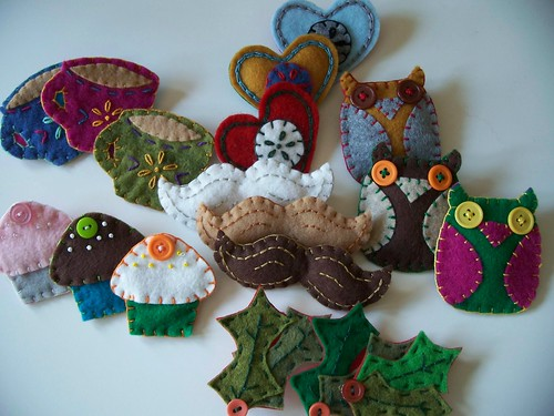 a gaggle of felt brooches