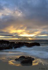 Longing... (Didenze) Tags: sunset seascape painterly texture vertical clouds rocks explore sunrays lagunabeach lightreflections canonrebelxsi exposurefusion didenze