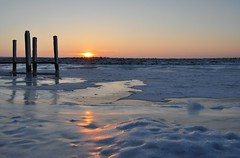 Warm reflection on a frozen surface.... a cracking experience (powerfocusfotografie) Tags: winter sunset sun cold reflection ice netherlands waddenzee landscape temperature groningen noordpolderzijl hoizon