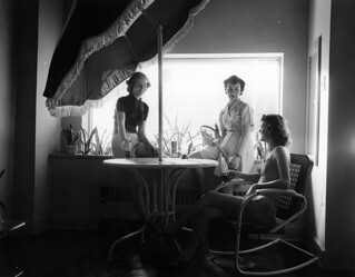 Women conversing and drinking soda at Unity House