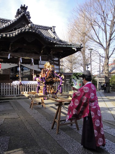 The Shinto priest purifies the portable shrine.