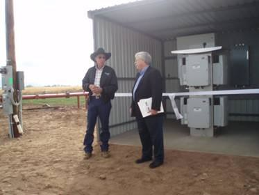 Harvey Allen and Arizona State Director Alan Stephens (Right) chat about the benefits of the new photovoltaic system funded with a USDA Rural Development REAP grant.