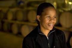 Women in wine cellar (World Bank Photo Collection) Tags: africa portrait people industry smiling southafrica women wine employment barrels winery processing agriculture development stellenbosch westerncape wineproduction livelihood socialdevelopment privatesectordevelopment