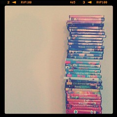 How does one arrange DVDs attractively?