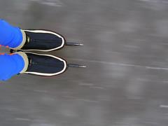 Flying (HoopjeEllende) Tags: 2001 blue winter black cold ice grey skating slide glide