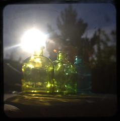 Watch your eyes... (Maureen Bond) Tags: ca sun sunlight glass outside shiny glare bottles kodak circles dirty flares ttv duaflexiii throughtheviewfinder chasethelight embracetheflare maureenbond yesidoshootintothesun