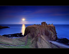 Moonrise Dunnottar Castle (angus clyne) Tags: ocean life old blue winter light sea sky cliff cloud sun moon mountain cold reflection tower castle history ice beach window rock stone wall night dark lens landscape island star golden coast scotland pier high haze ancient warm europe long exposure shine aberdeenshire angle time angus earth path tide horizon low hill north wide dream scottish calm east beam explore aberdeen filter shore lee hour round land 20mm rise magical fortress dunnottar clyne colorphotoaward canon5dmarkii