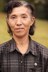 The Caretaker, DPRK (Lachlan Towart) Tags: travel people woman asia portait korea northkorea dprk 6millionpeople nationalgeographicfacesoftheworld natgeofacesoftheworld