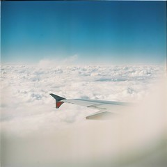 Up In The Clouds (Brendan_Timmons) Tags: yashicamat tlr yashinon 80mmf35 120 film kodakektacolorpro160 aeroplane clouds sky wings blue window fluffy whisp white 6x6