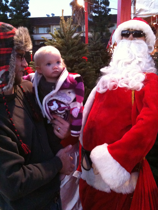 delilah at the christmas tree lot with hollywood santa manequin