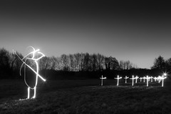 Some Corner Of A Field (Black and White Light Painting) (flatworldsedge) Tags: world family trees light white black field grass silhouette night painting soldier war wwi salute crosses brooke graves led torch flare flashlight rupert rickmansworth lr3 aquadrome gnd explored somecorner yahoo:yourpictures=family