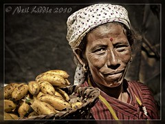 Bananas for breakfast? (NeilsPhotography) Tags: travel nepal portrait woman slr wow interestingness amazing interesting eyes asia great explore bananas vendor hindu tika 2010 outstanding lr3 mutedcolor npl mutedcolours lamjung 550d cs5 canon550d neilliddle gandakzone landseavision liddlephotography