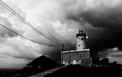 A clouded childhood... (Gremxul) Tags: sky blackandwhite bw lighthouse storm black lines architecture clouds composition contrast canon perspective highcontrast shades powershot gorda gozo g12 blackwhitephotos gremxul maltaarchitecture canong12 canonpowershotg12 powershotg12 tagordanlighthouse